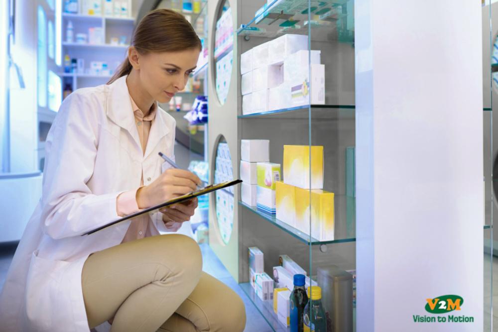 pharmacist doing inventory at drug store